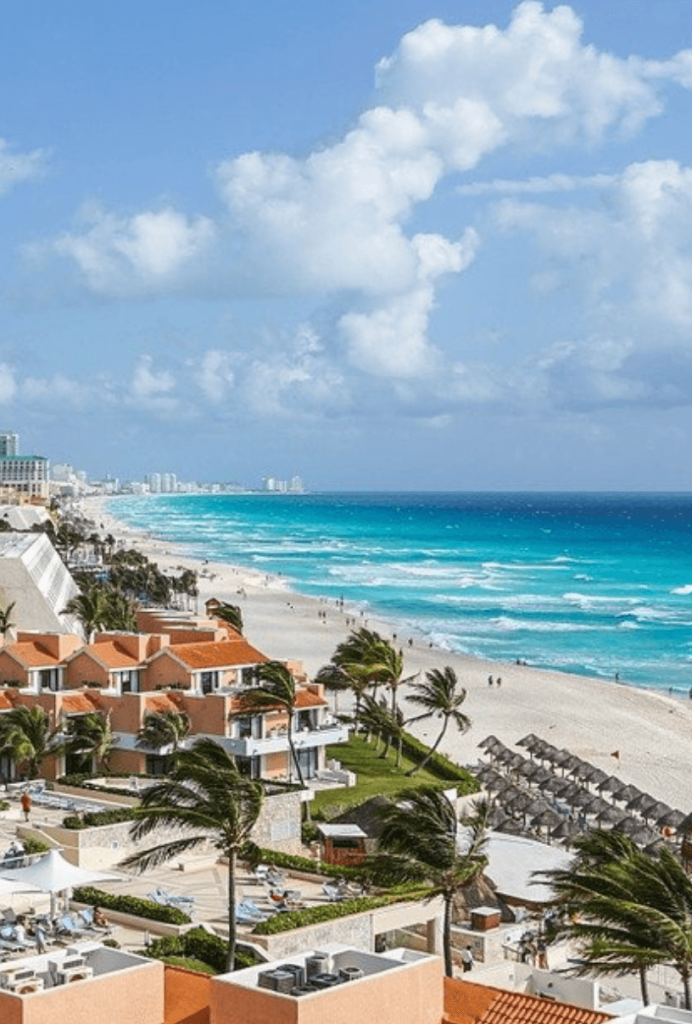cancun beach hotel along turquoise waters